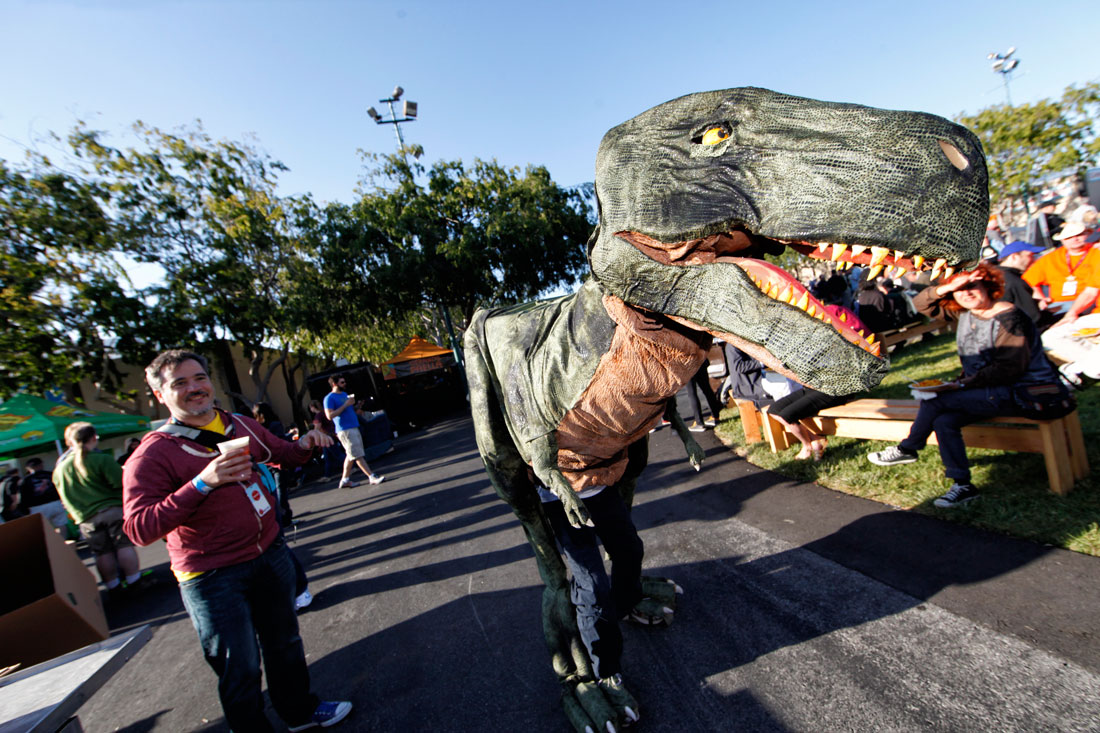 Walking dinosaur on fun, sunny day at Maker Faire by Becca Henry Photography