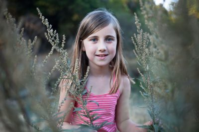 Girl surrounded by tall grass- Family photography by Becca Henry Photography