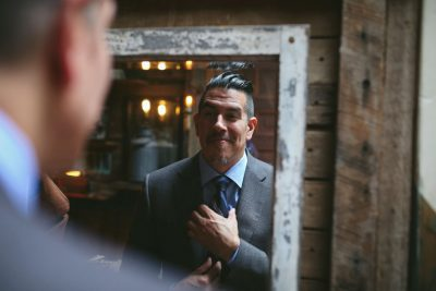 Groom getting ready at Carousel Consignment by Becca Henry Photography