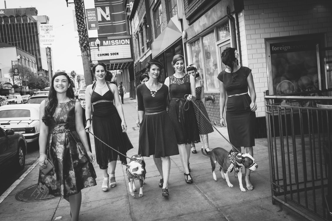 Wedding guests walking dogs in the Mission, SF by Becca Henry Photography