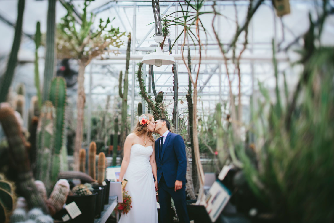 Bride and groom in the greenhouse at Berkeley Botanical Garden by Becca Henry Photography