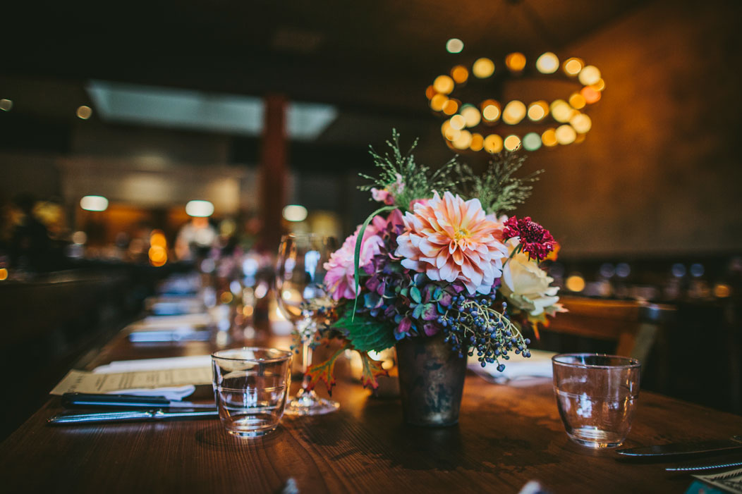 Wedding flower arrangement at wedding reception at Oakland venue, El Camino by Becca Henry Photography