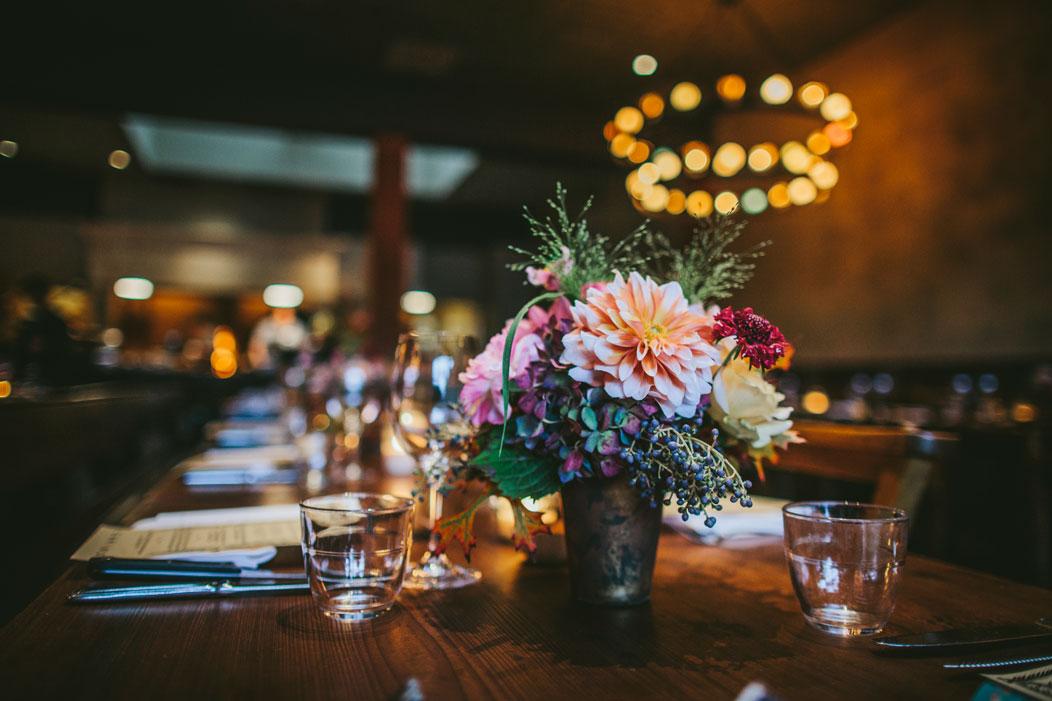Wedding flower arrangement at wedding reception at Oakland venue, El Camino by Becca Henry Photography