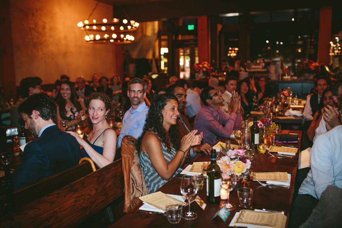 Guests clap for toast at a wedding reception at El Camino, an Oakland venue by Becca Henry Photography