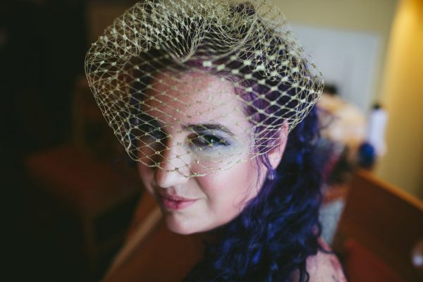 Bride who just had a make-up done with rad purple hair at Waterfront Hotel by Becca Henry Photography.