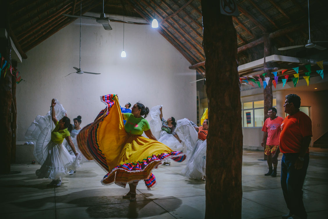 Woman in beautiful colorful skirts practicing traditional dances in Mexico by Becca Henry Photography