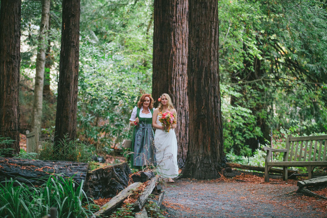Bride coming down the aisle in the Redwood Grove by by Becca Henry Photography