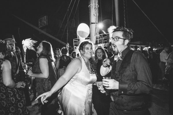 Wedding couple dancing the night away at the reception on the SS Red Oak Victory by Becca Henry Photography.