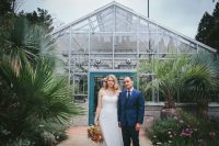 Bride and groom in front of greenhouse at Berkeley Botanical Garden by Becca Henry Photography