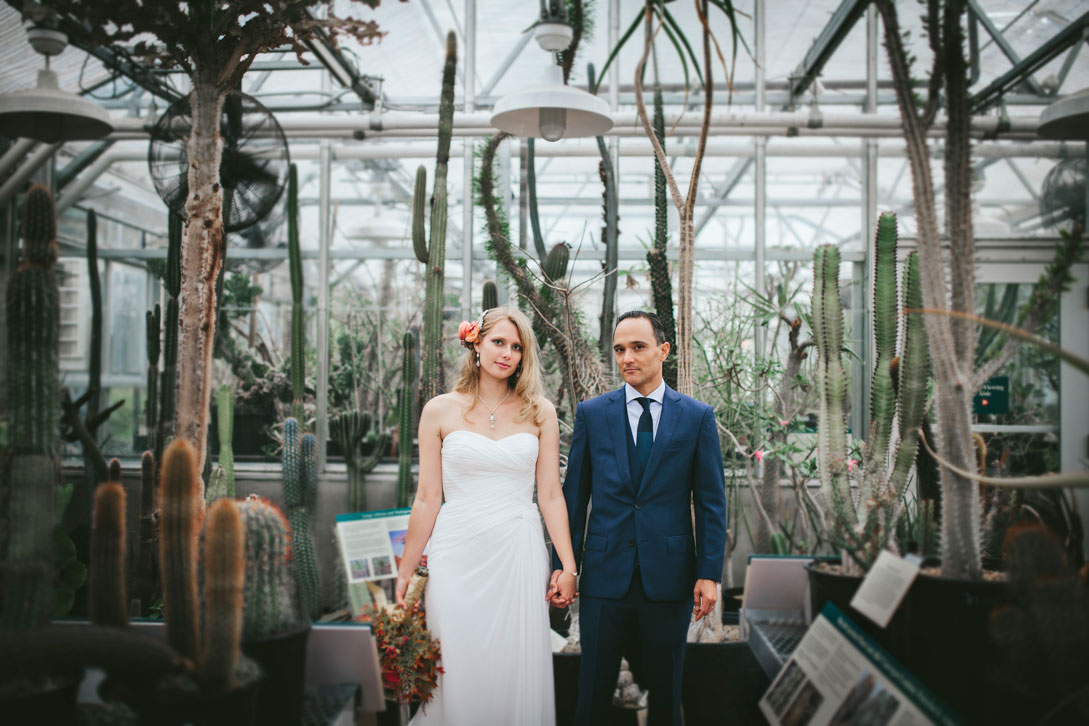Bride and groom in greenhouse at Berkeley Botanical Garden by Becca Henry Photography