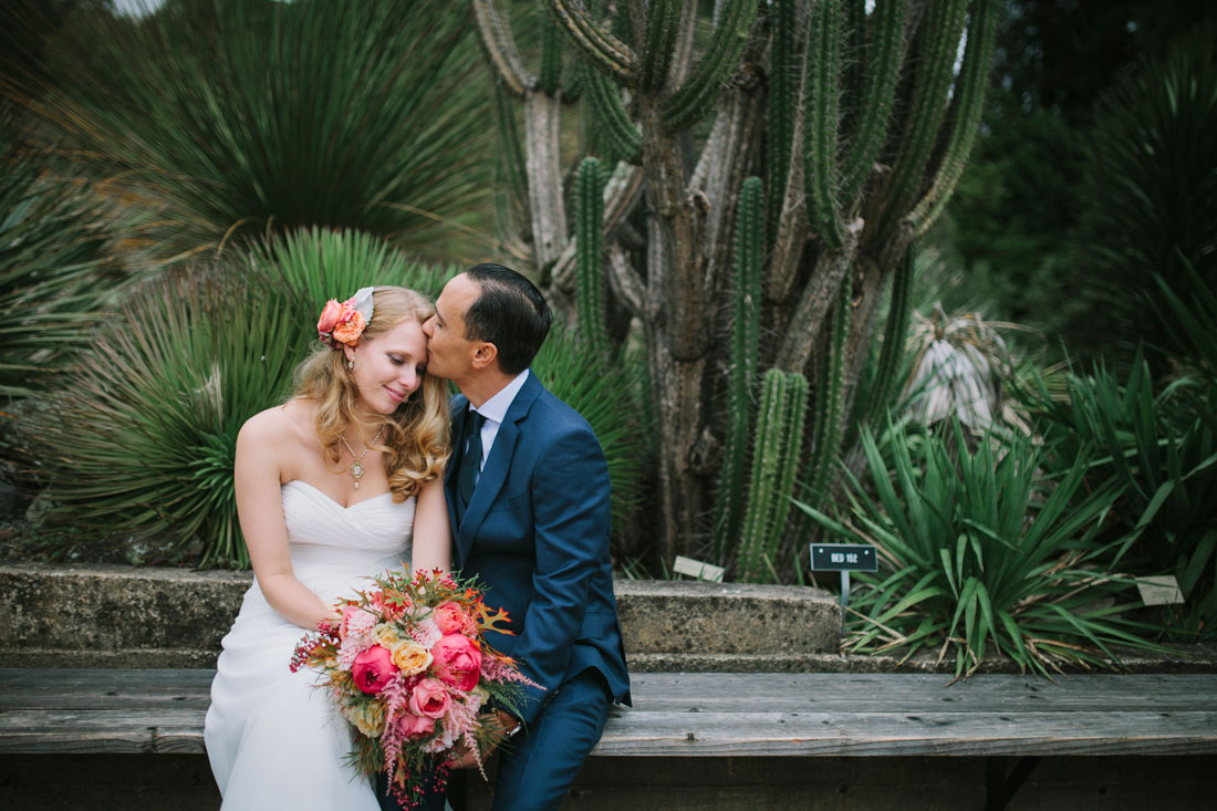 Berkeley Botanical Garden-groom kisses bride by Becca Henry Photography