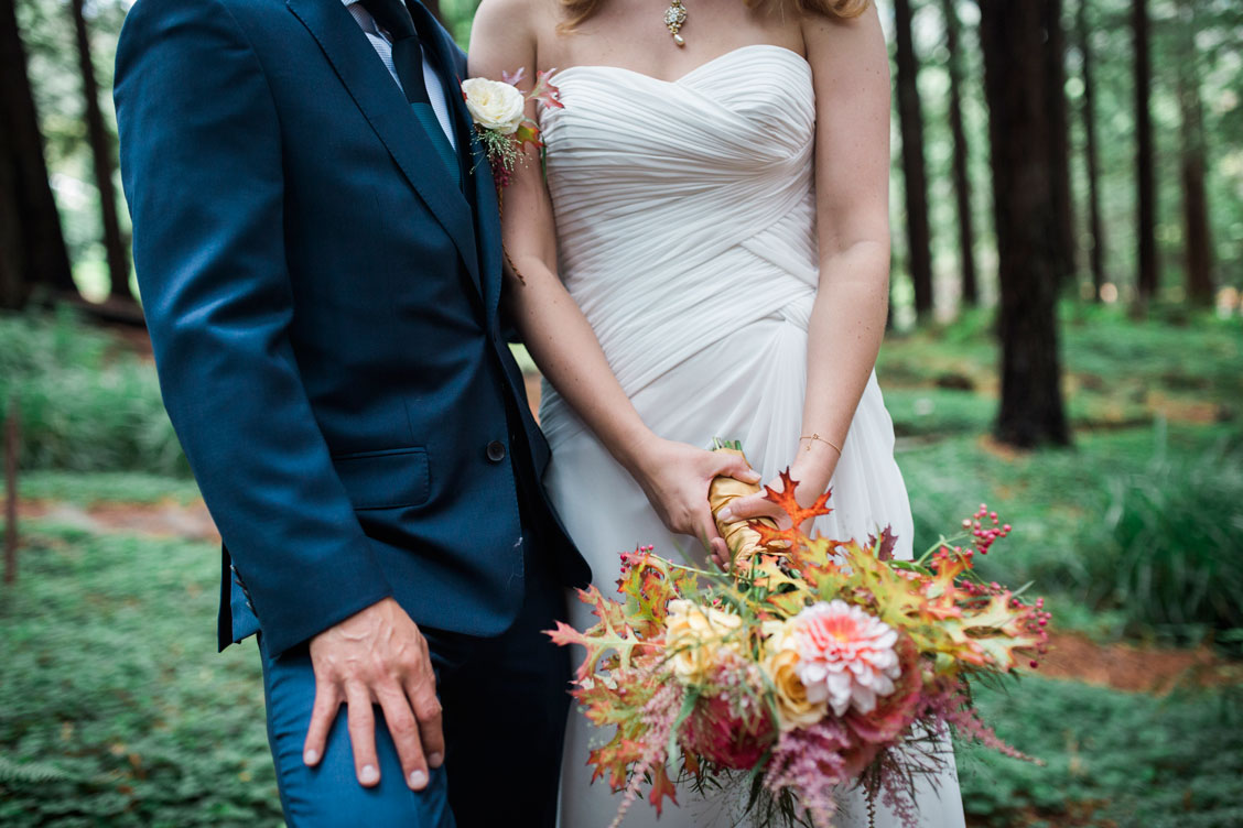 Bride and groom in Redwood Grove in Berkeley Botanical Garden by Becca Henry Photography