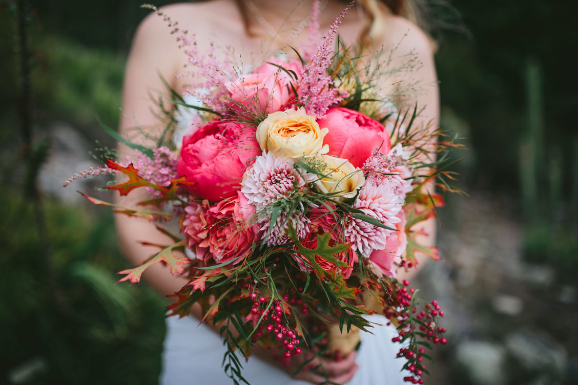 Bride holing pink bouquet at Berkeley Botanical Garden by Becca Henry Photography