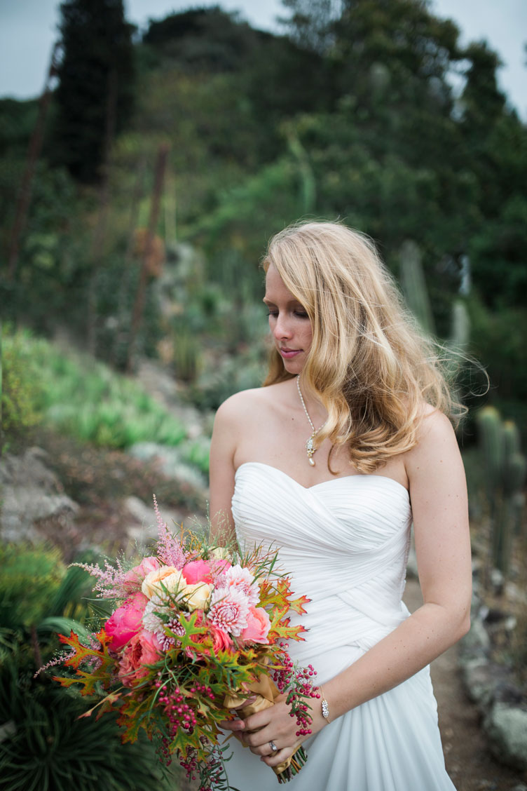Bride holding pink bouquet at Berkeley Botanical Garden by Becca Henry Photography