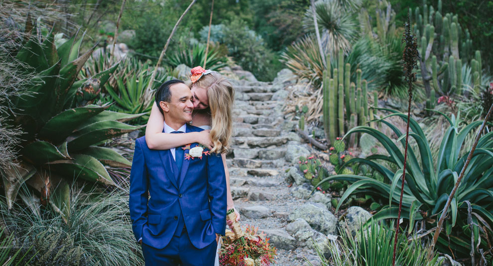 Bride hugs groom at Berkeley Botanical Garden by Becca Henry Photography