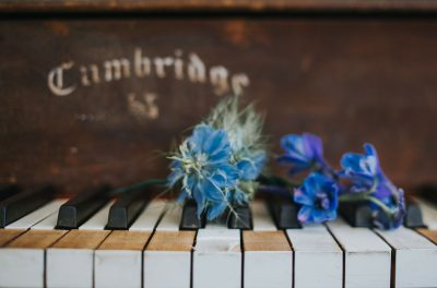 Mendocino wedding detail - flowers on piano by Becca Henry Photography