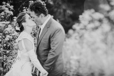 Beautiful Mendocino couple in the garden by Becca Henry Photography