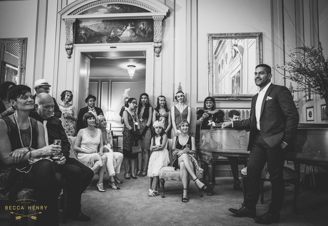 Oakland Bellevue Hotel Wedding Ceremony- Friend sings to couple at ceremony by Becca Henry Photography