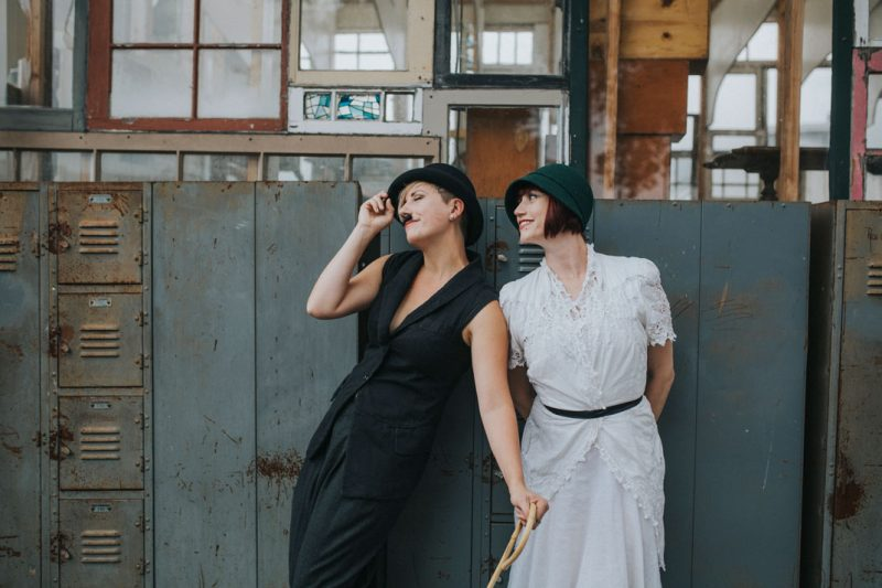 Swoon - Day after wedding session at Ohmega Salvage in Berkeley- dressed as Charlie Chaplin and ingenue in front of vintage lockers by Becca Henry Photography