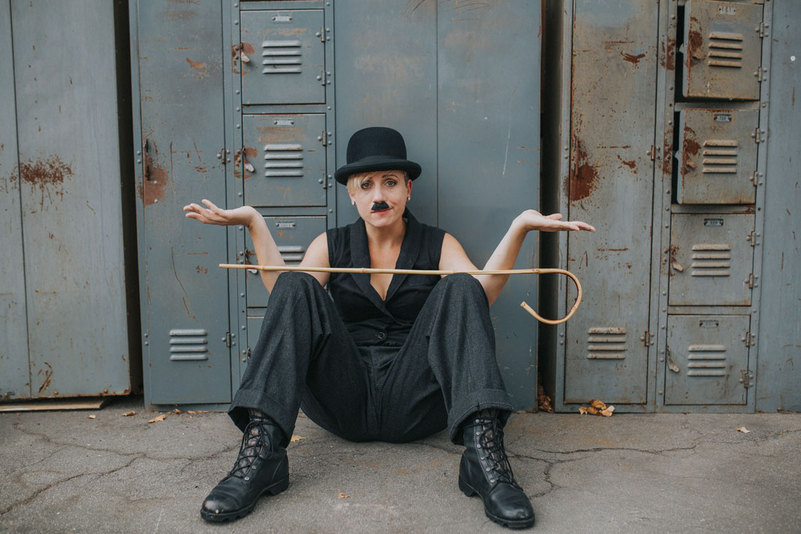 Day after wedding session at Ohmega Salvage in Berkeley- dressed as Charlie Chaplin in front of vintage lockers by Becca Henry Photography