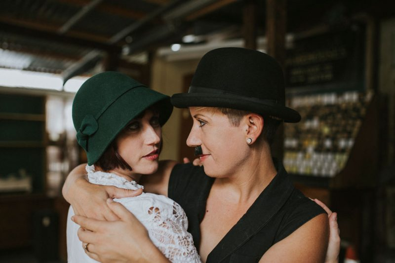 Day after wedding session at Ohmega Salvage in Berkeley- dressed as Charlie Chaplin and Ingenue by Becca Henry Photography