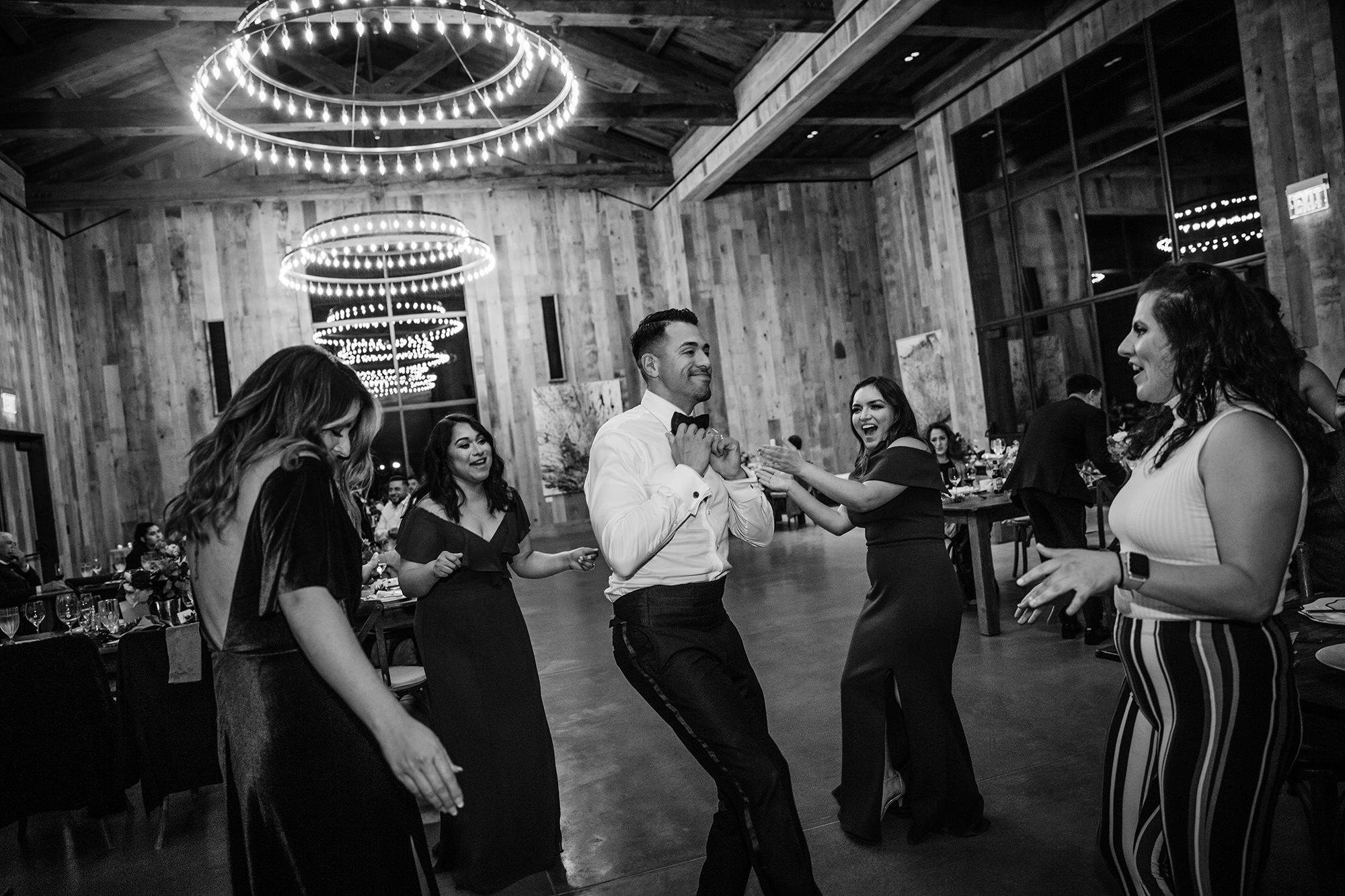 Groom dancing with wedding crew at St Helena Wedding.
