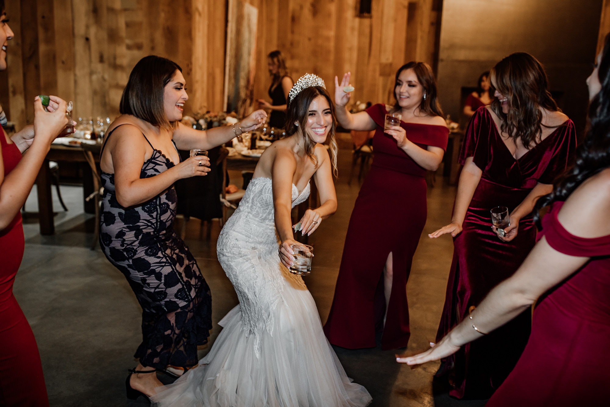 Bride and bridesmaids dancing at the Brasswood Wedding Venue.