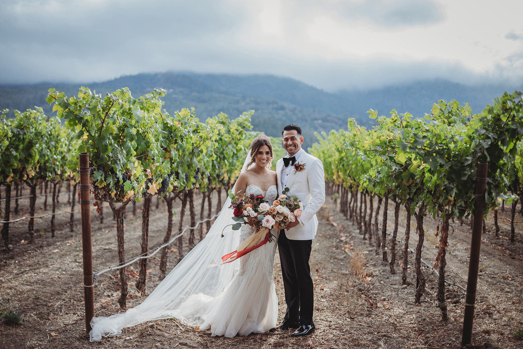 Bride and groom in the vineyard at Harvest Inn in St Helena.