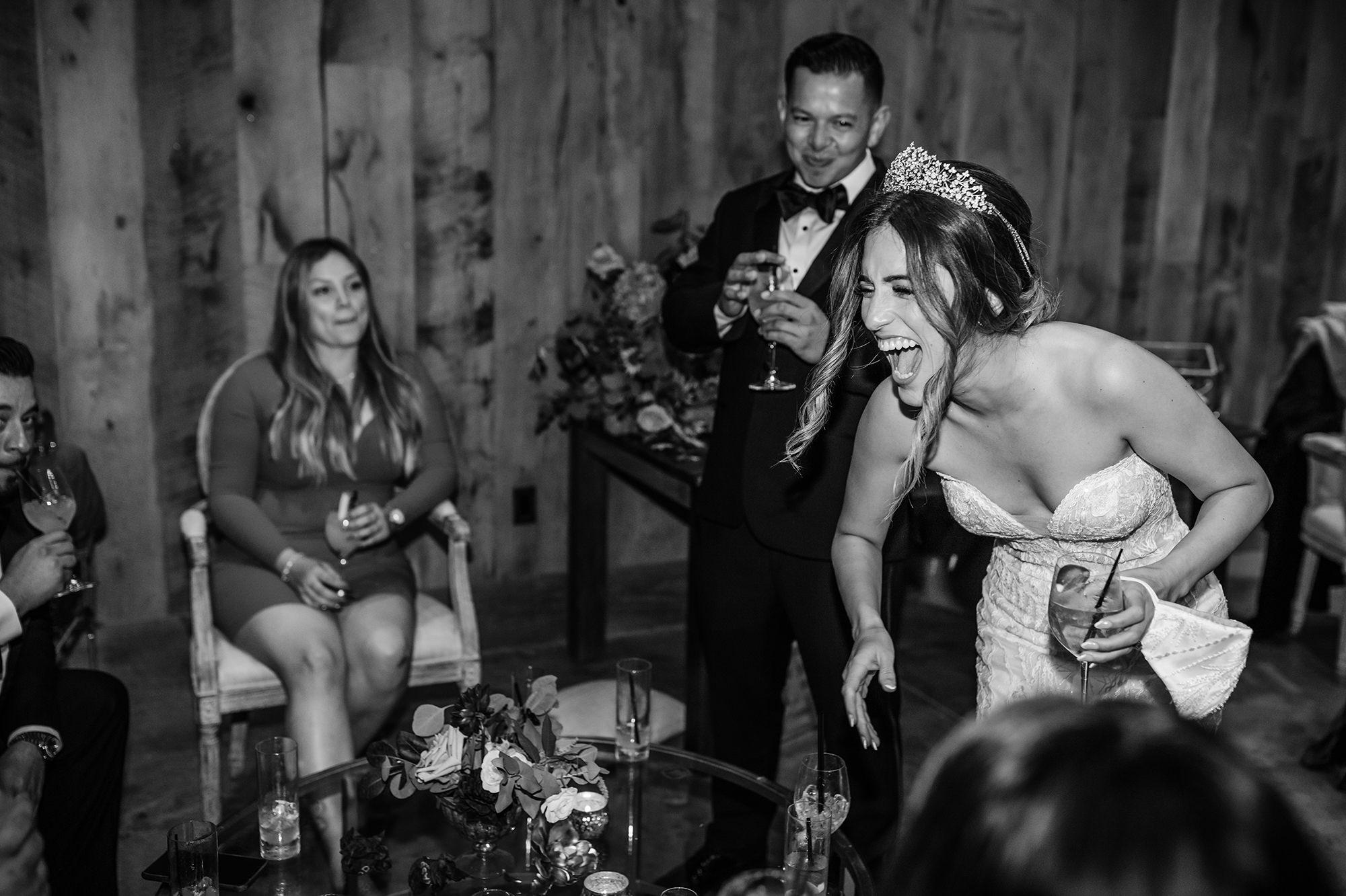 Bride having fun at wedding reception.