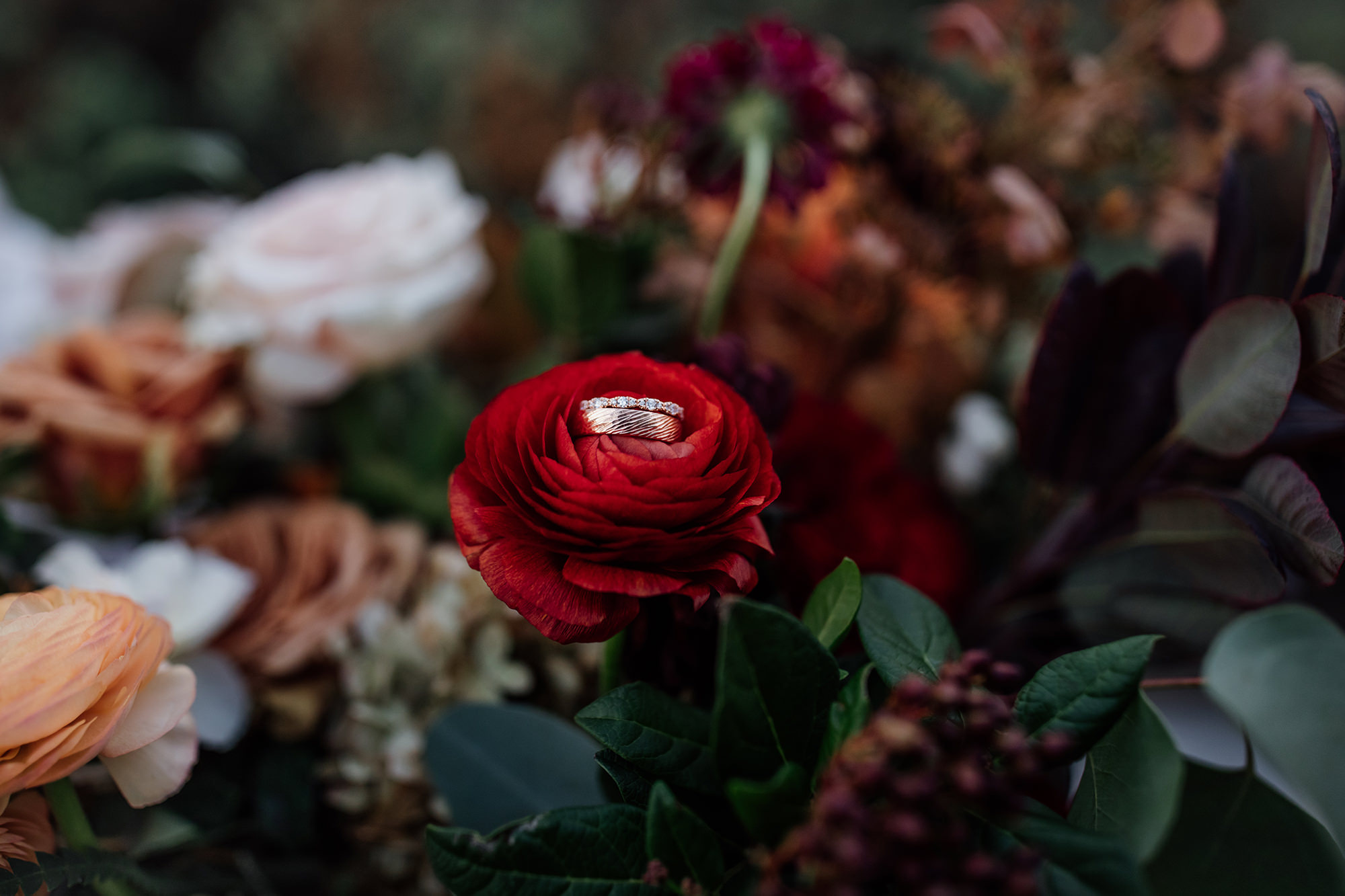 Wedding rings in beautiful bouquet at Nap Valley wedding.