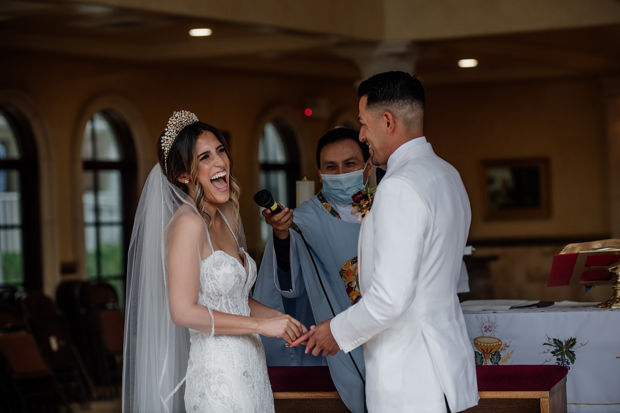 Bride and groom laughing at wedding ceremony at St Helena Catholic Church