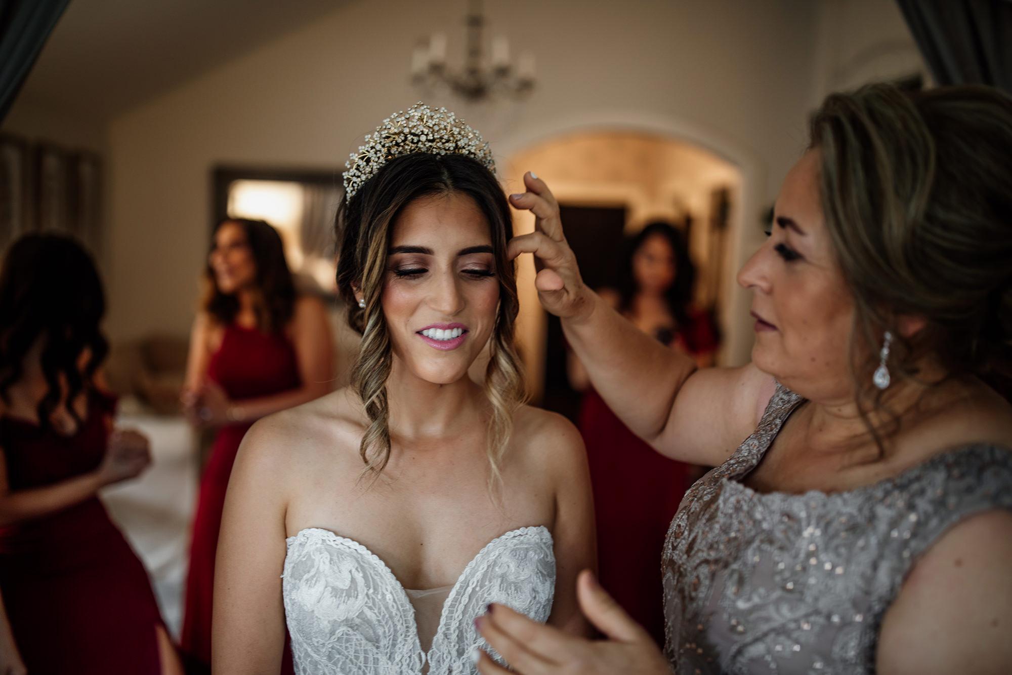 Mom helps bride put veil on at St Helena wedding.