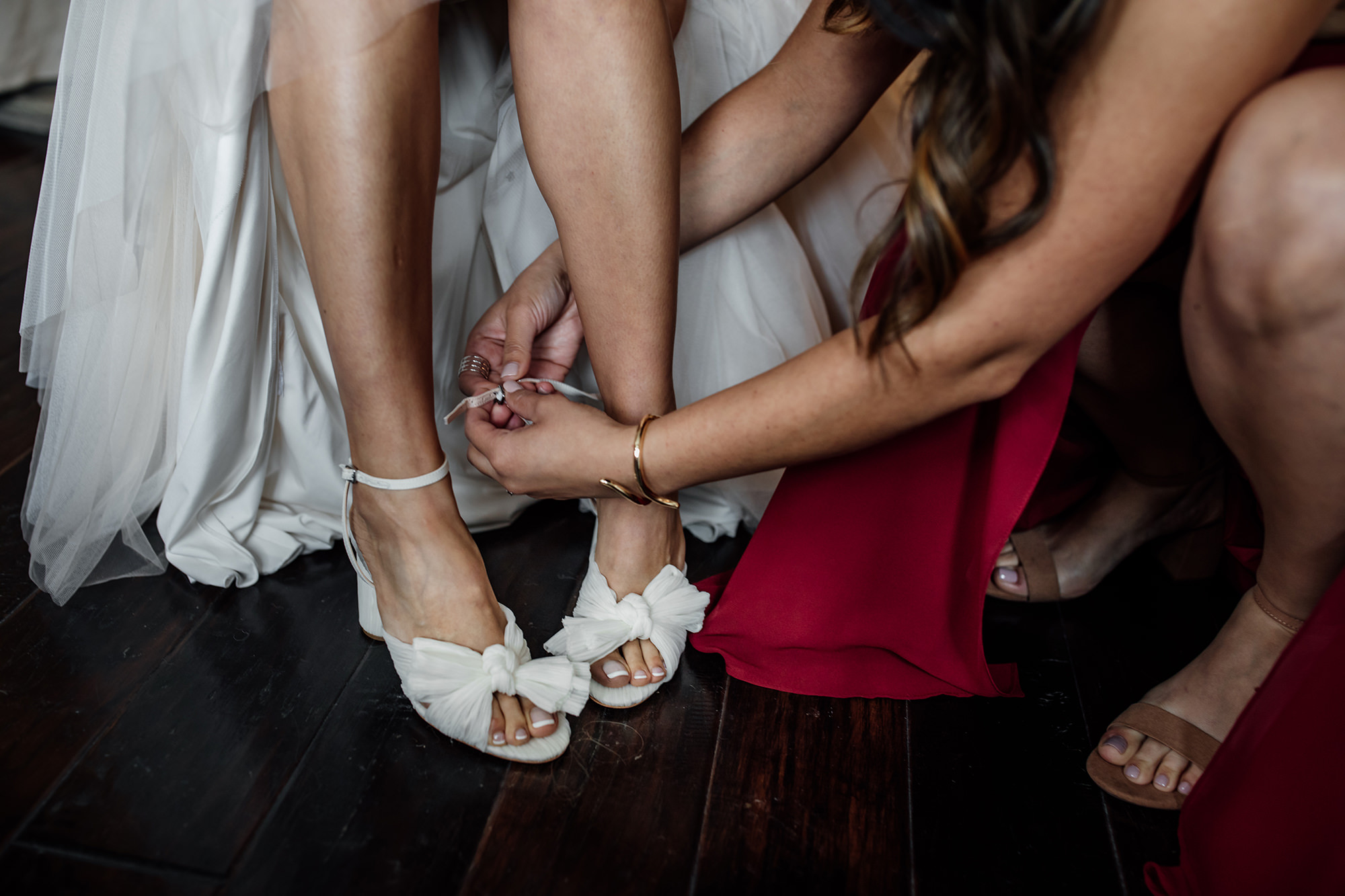 Bride putting on gorgeous shoes at St Helena wedding