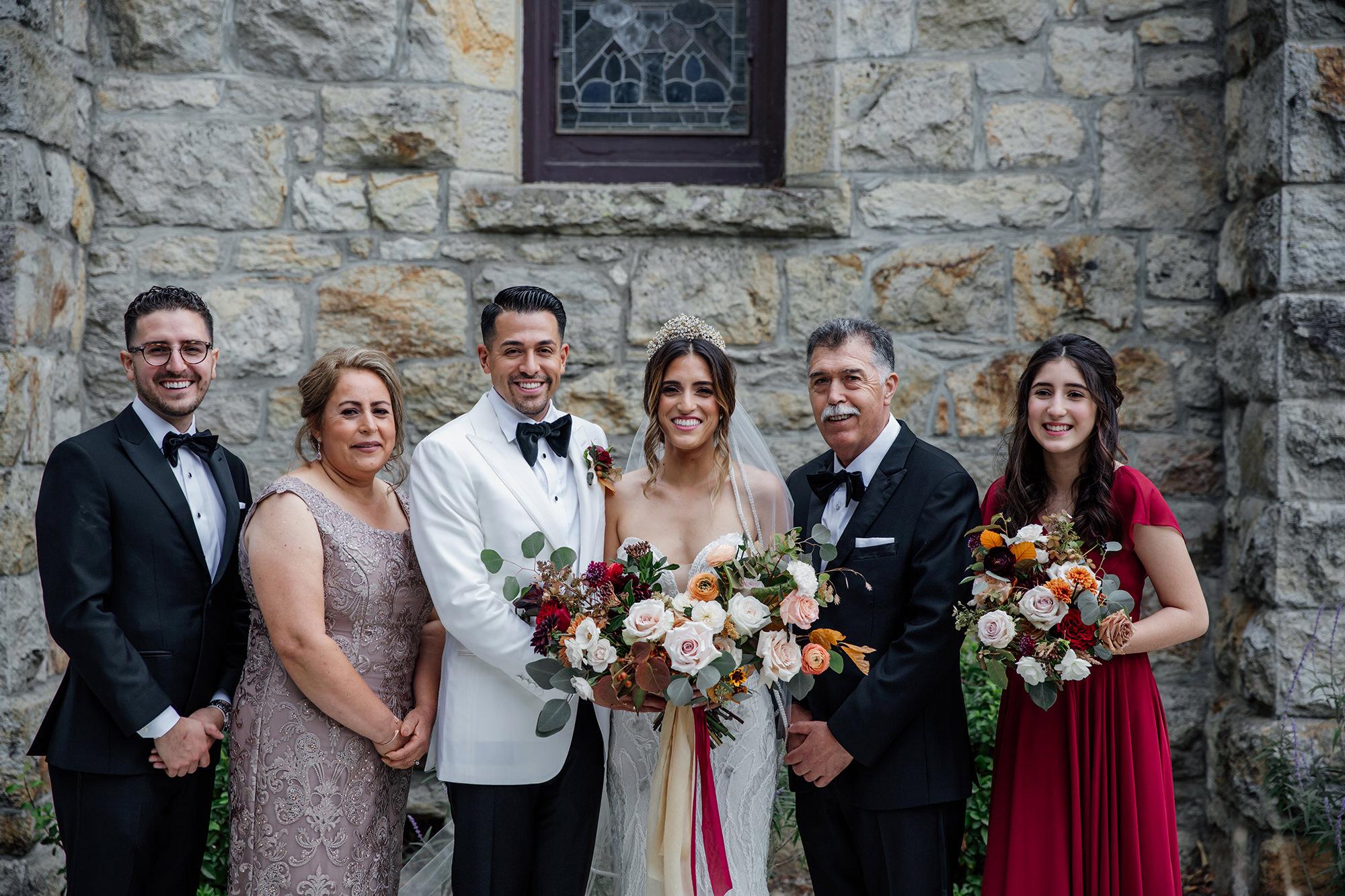 Family photos after wedding ceremony at St Helena Catholic Church