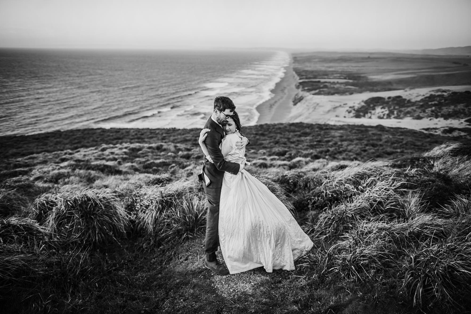 BW photo of a sweet moment overlooking the beach during their Point Reyes elopement.