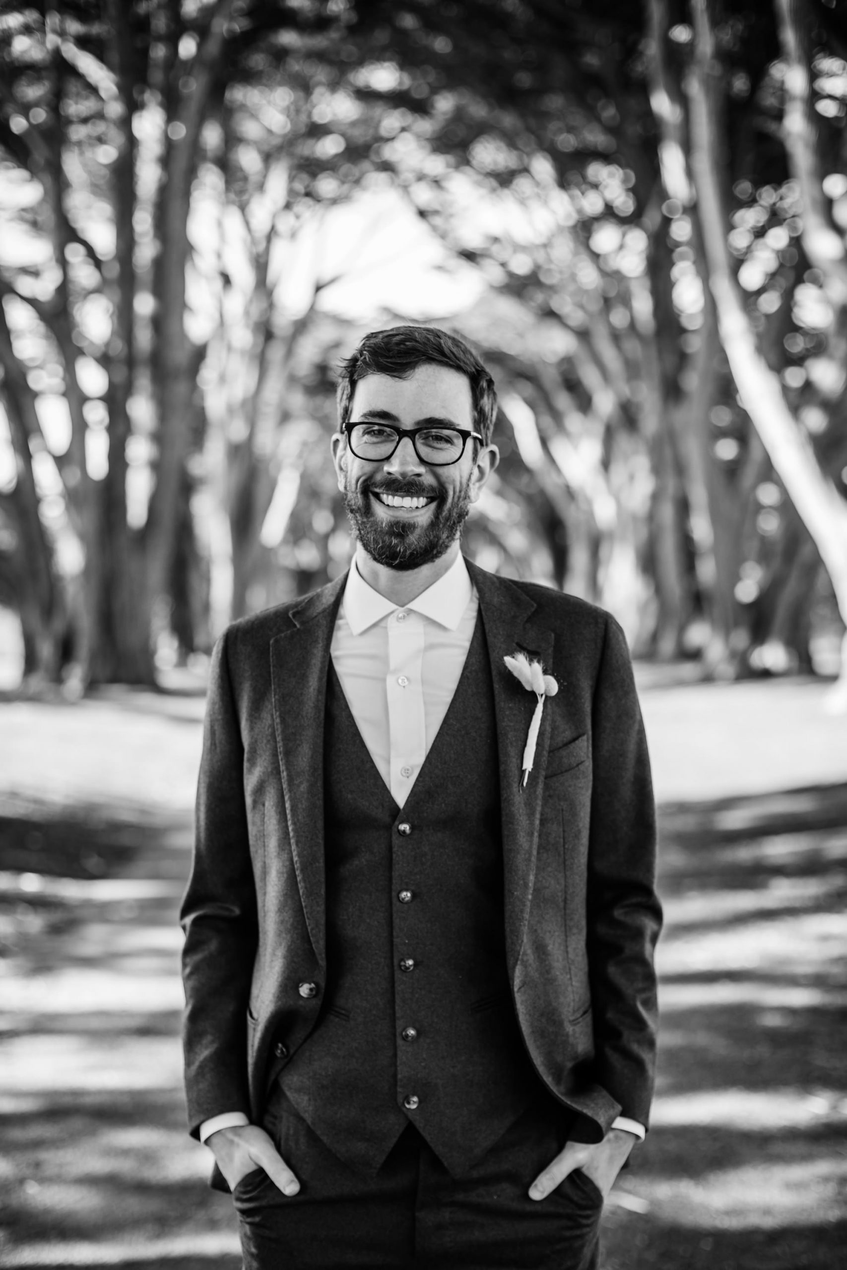 BW portrait of groom at the Cypress Tree Tunnel for Point Reyes Elopement.