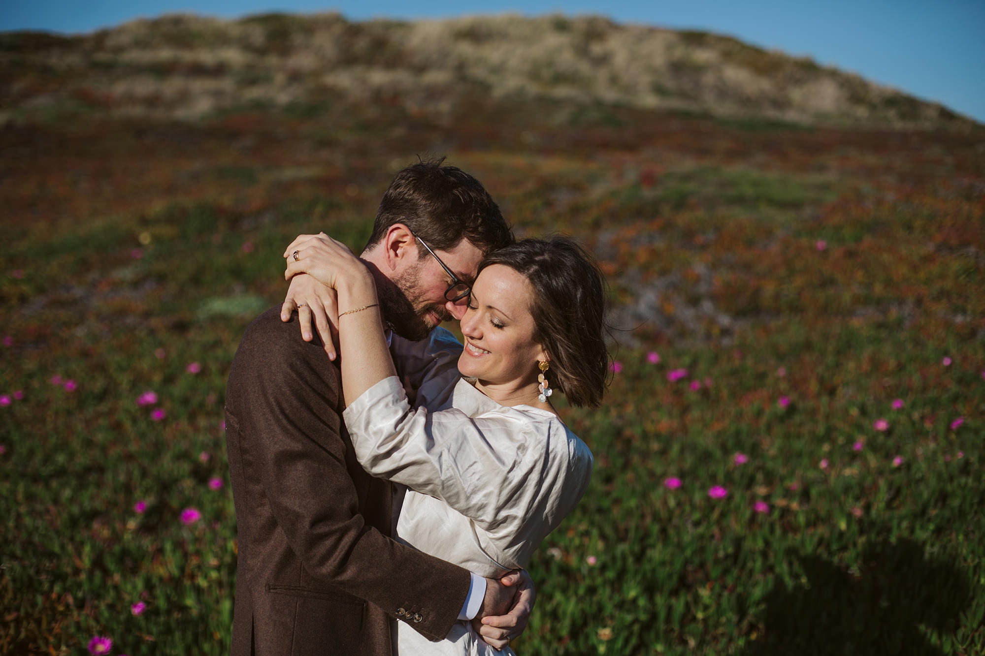 Groom hugs bride for for Point Reyes Elopement.