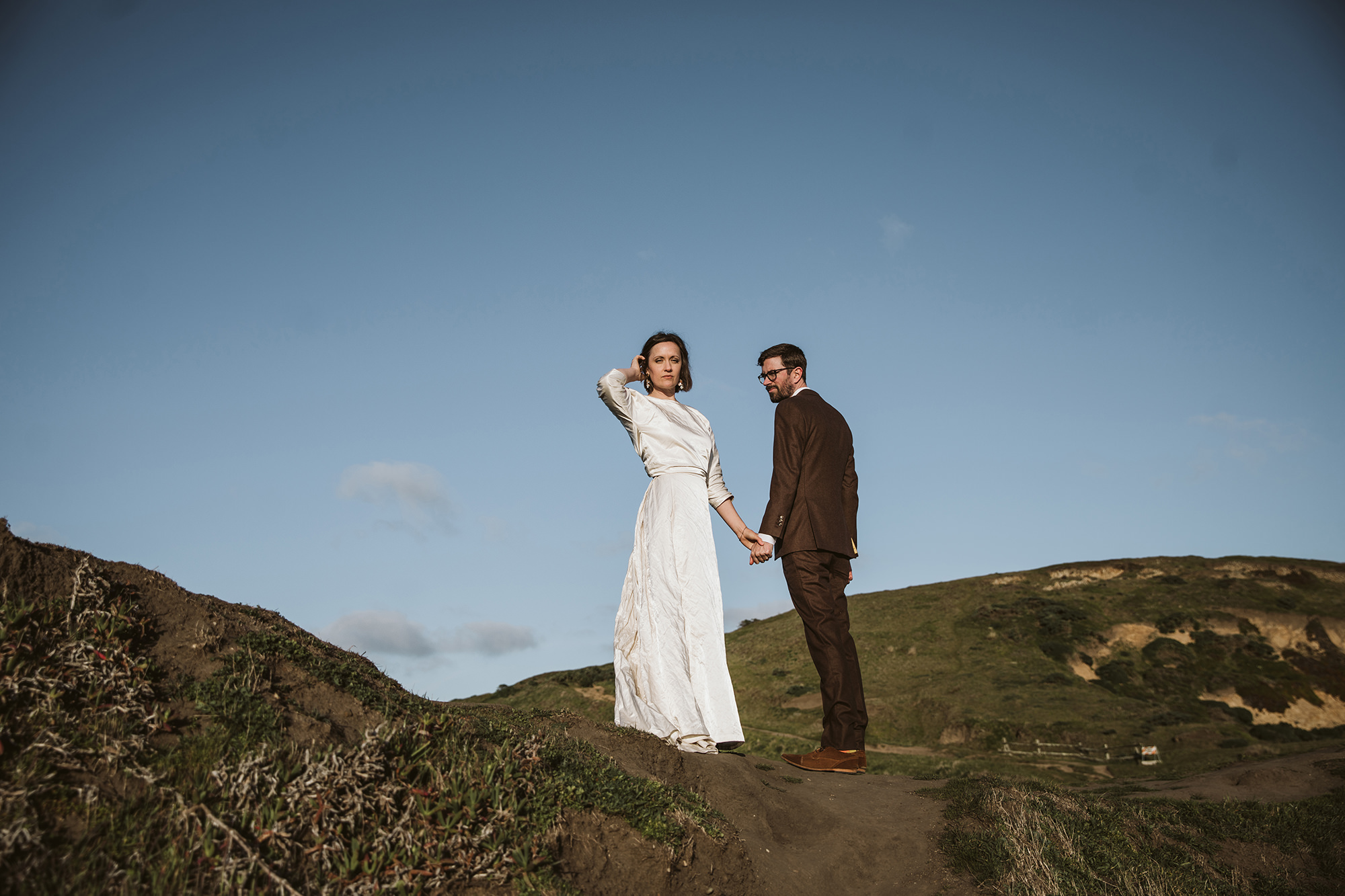 Bride taking in the scene atop the cliff during their Point Reyes elopement.