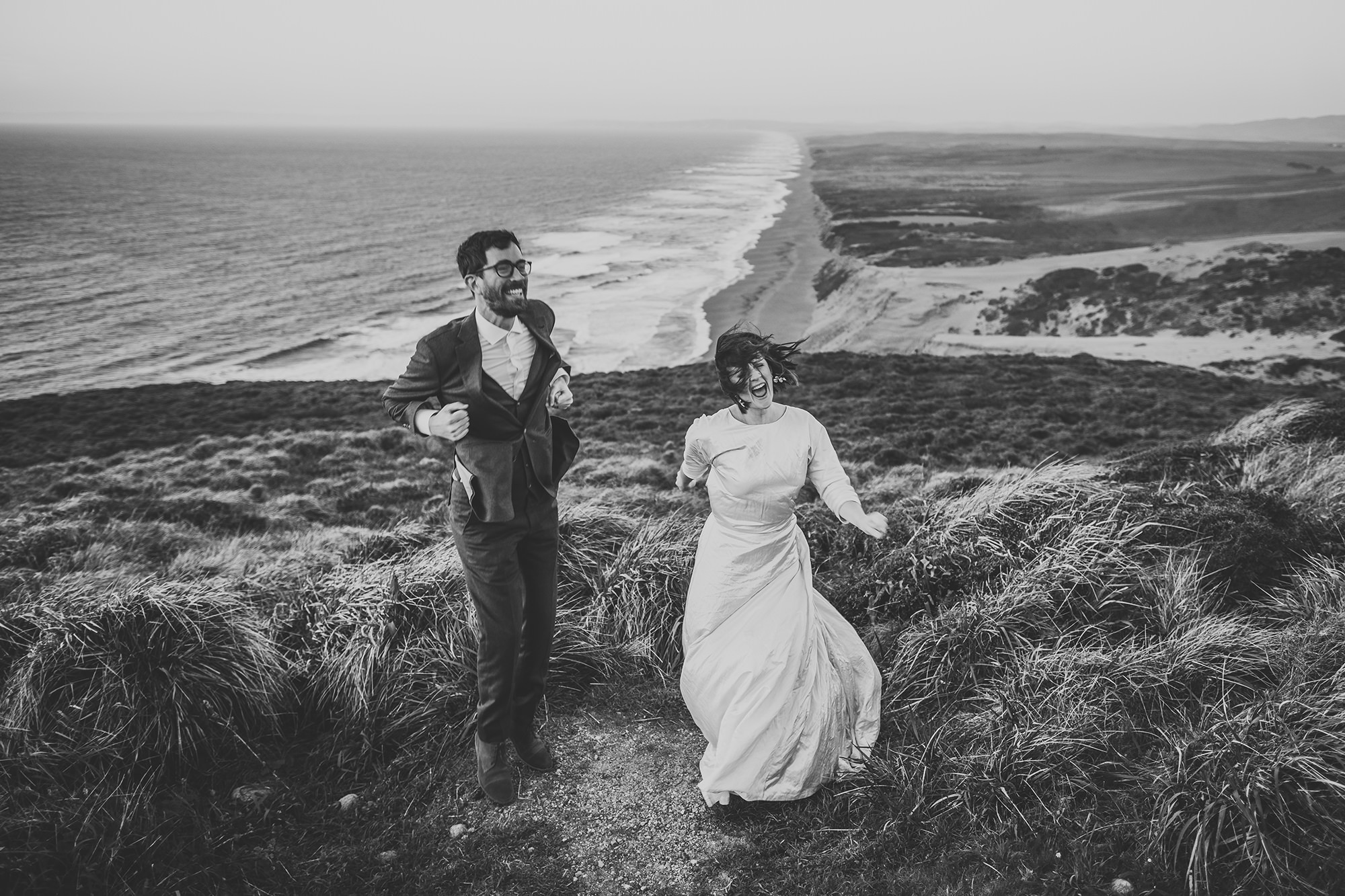 Bride and groom jump up and down to keep warm ..and just having fun during their Point Reyes elopement.