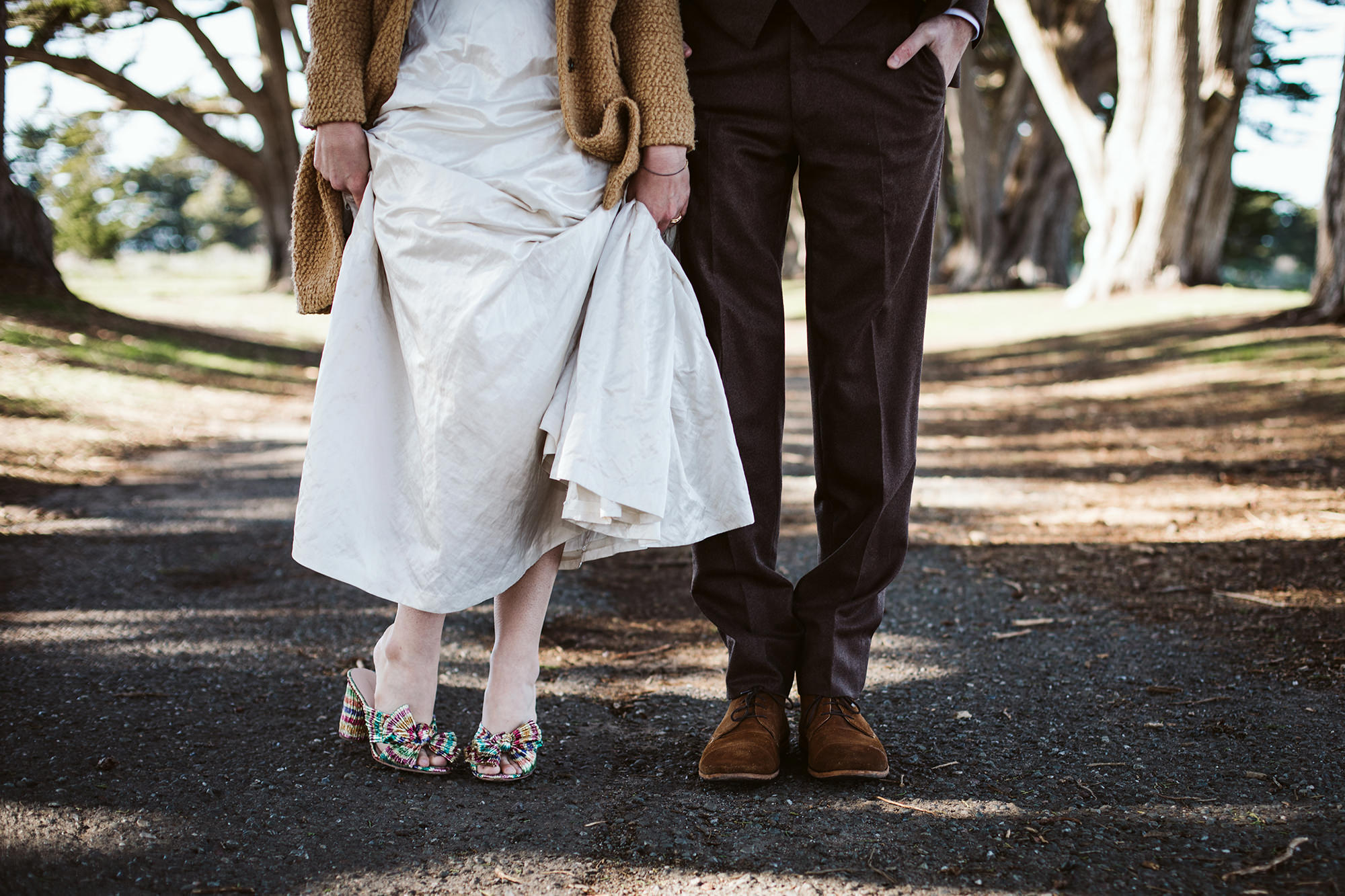 Checking out the bride and groom's snazzy shoes the Cypress Tree Tunnel for Point Reyes Elopement.
