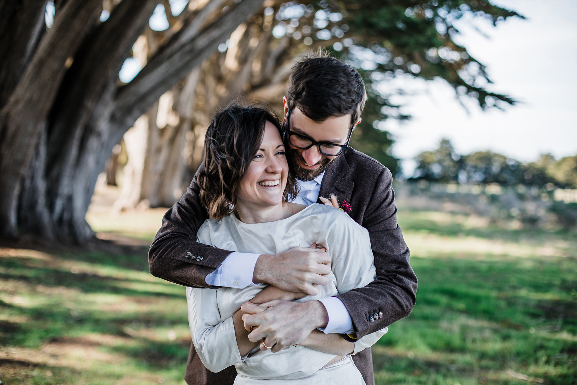 Groom and Bride having fun the Cypress Tree Tunnel for Point Reyes Elopement.