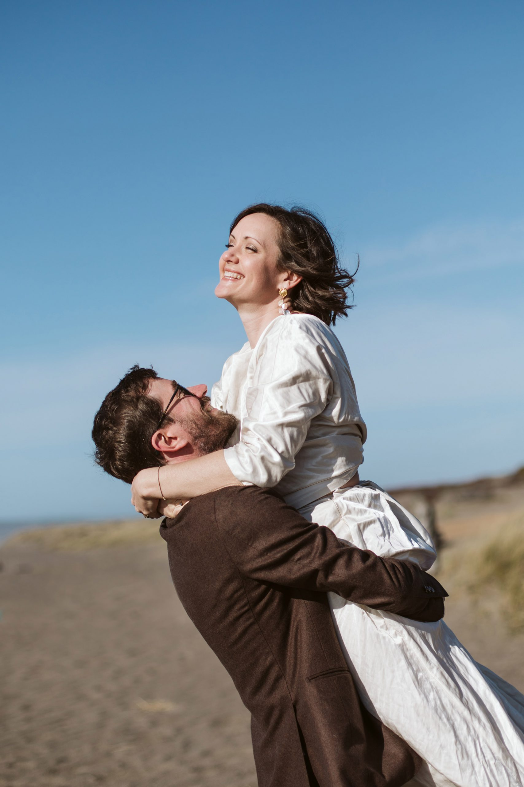 Bride and groom playing during an adventurous California elopement.