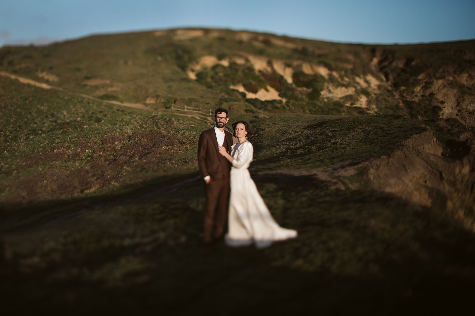 Bride and groom in the sunset during their Point Reyes elopement.