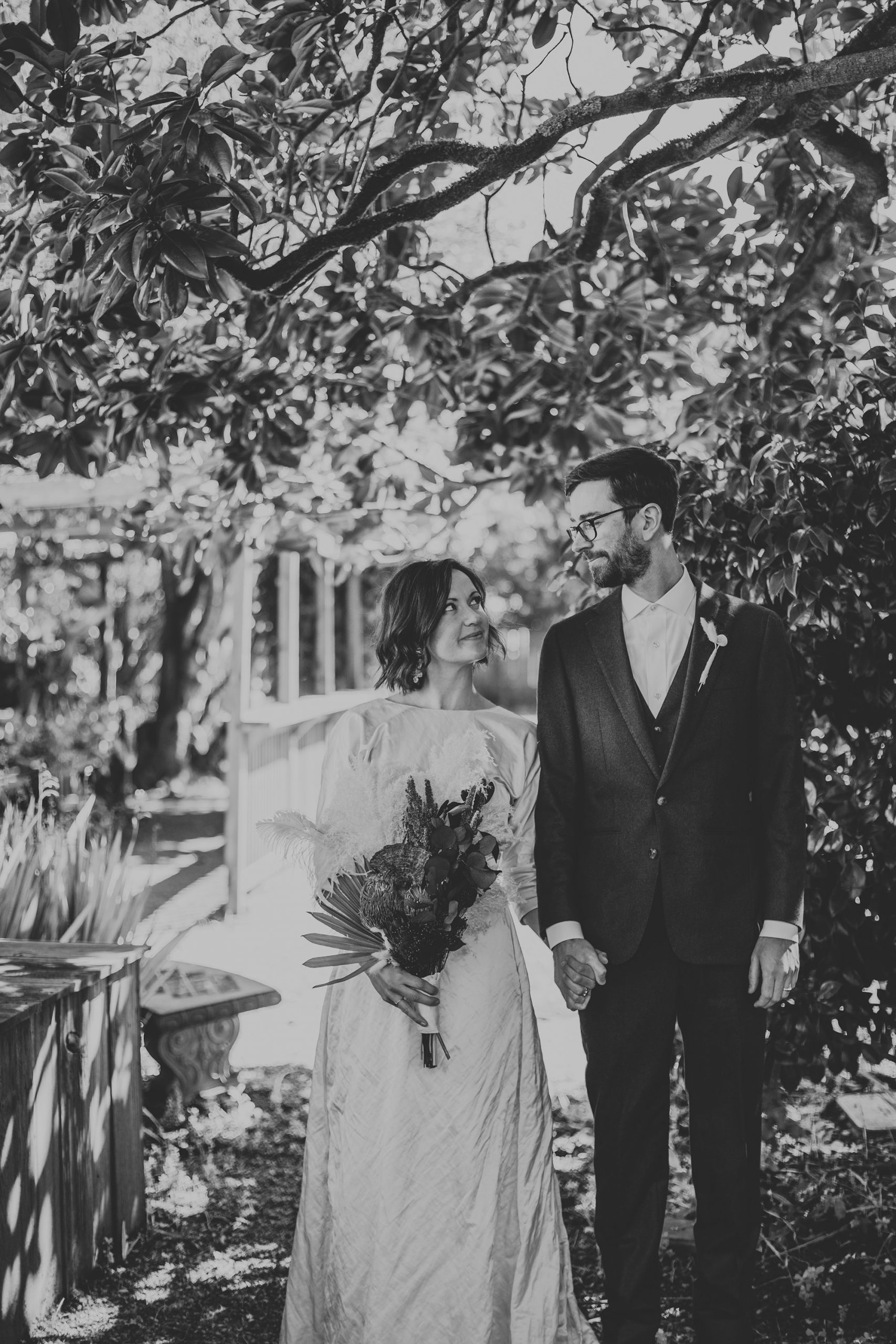 Bride and groom kiss at Olema House for Point Reyes elopement