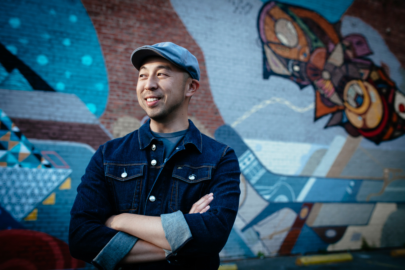 Becca Henry Photography- Visual Branding - Oakland- portrait of DJ Bluz in front of downtown Oakland mural