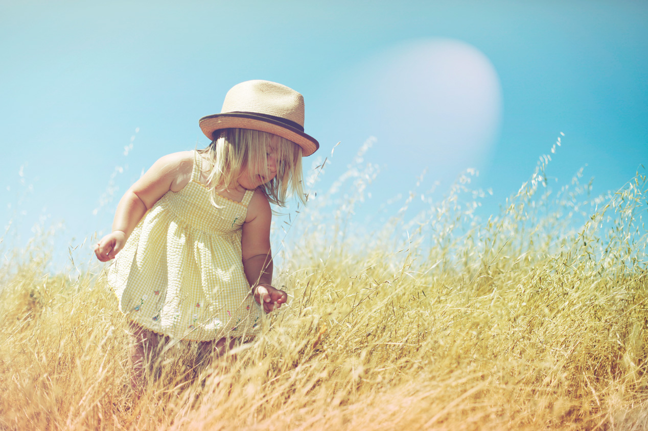 Becca Henry Photography- Little girl with a fedora in a golden field -Fairfax California