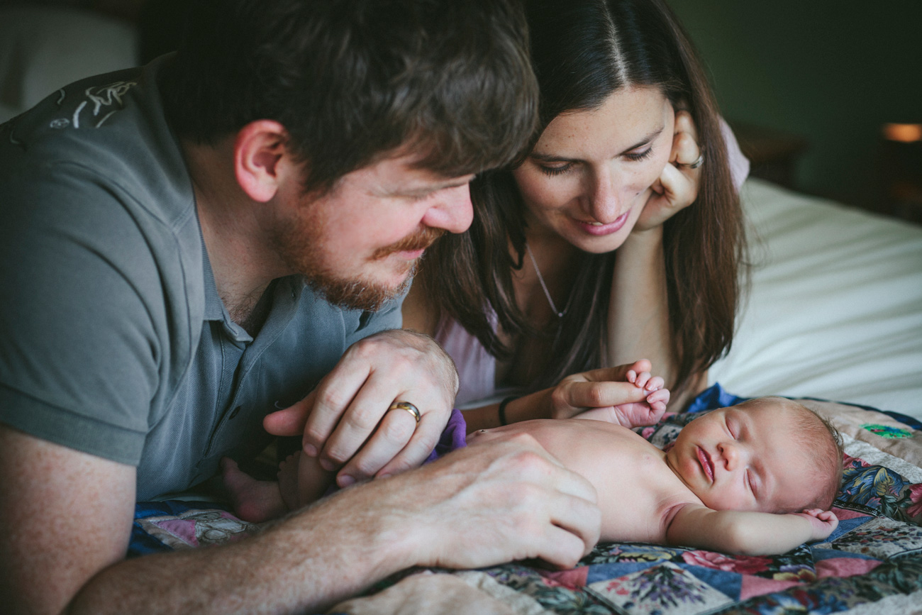 Becca Henry Photography - Newborn Photography in Oakland- parents looking over newborn
