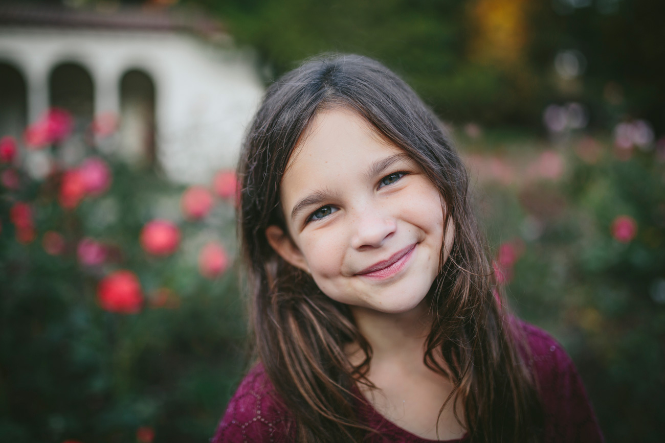 Becca Henry Family Portraits- smiling girl in Morcom Park in Oakland